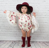 baby girl toddler long sleeved bell top with floral designs. Sleeves are belled at the bottom and trimmed with lace. The romper has snaps conveniently located at the bottom.