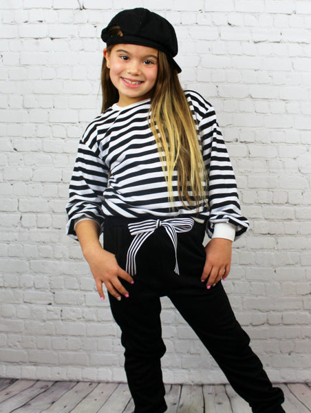 "This two piece Chill Set is a super fashionable ""everyday"" outfit. The long sleeves have added fabric to make them puff out slightly and the pants are tied with a bow. The pants come tight around the ankle. Your little Diva / Tween girl is going to love how comfy it is!"