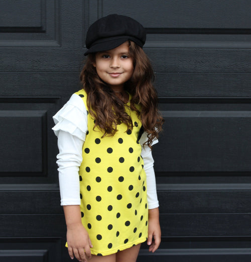 This fun polka dot dress is the perfect piece for a party! We have two vibrant colors in stock -Pink and Yellow. Both colors have long sleeves attached with ruffles on the shoulders. A bow sits on the left chest.