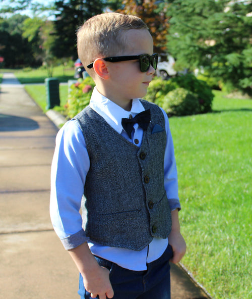 The Charlie 4 piece set is for the sophisticated little gentleman. This fashionable trendy toddler boy outfit comes with Long Sleeve Collared Shirt, Bowtie, Vest, and Jeans