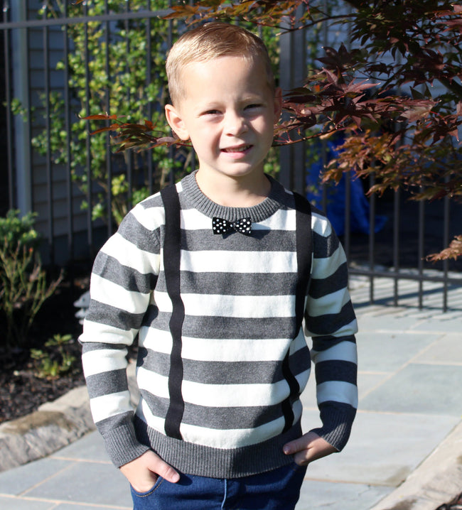 his trendy baby boy's grey striped sweater comes with attached suspenders and a black bow tie with white polka dots.