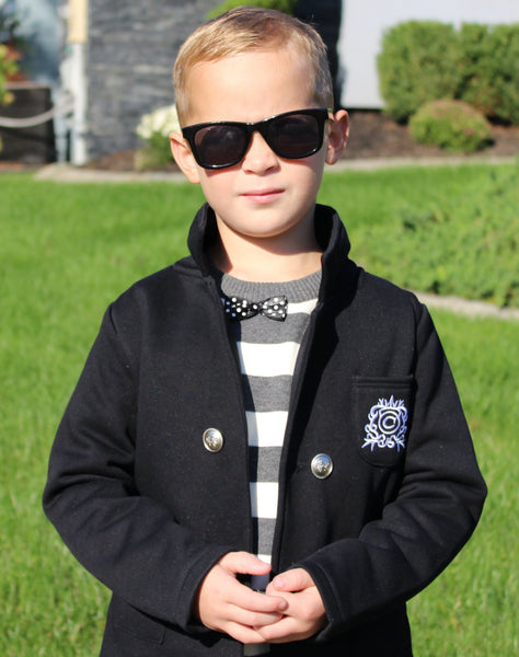 This BLACK blazer is perfect Fall gentlemen attire for you toddler boy. The collared jacket has 4 buttons lining the front and two in the back. We love this look with a white shirt and jeans. So adorable!