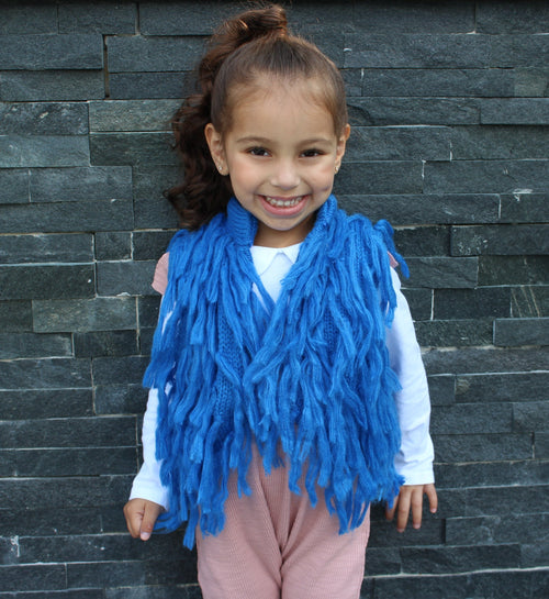 Dress your mini Diva's in this gorgeous blue pop of color for the upcoming Fall season. This vest has hooks that fasten the front closed. The Blue Fringe Vest is light and can be worn underneath a jacket if need be.