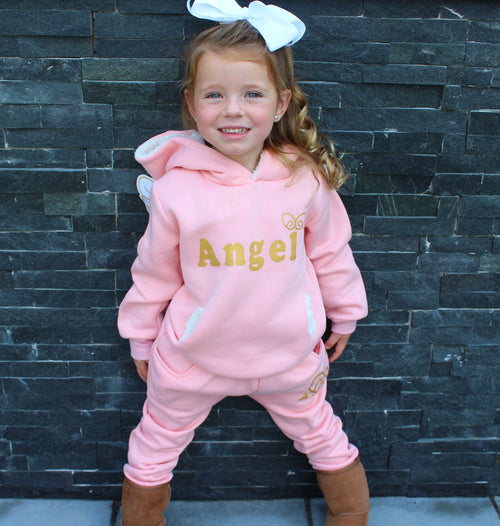 Keep your little Angel nice and cozy in the cold weather with this two piece sweatsuit. This set comes with a hooded sweatshirt and sweatpants. The back of the sweatshirt has two angel wings that stick out turning your mini fashionistas into little angels! Keep them super comfortably and at the same time very stylish.