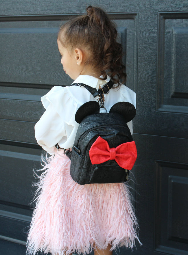If you love Disney as much as we do then you are going to love this Minnie inspired leather backpack. The two Minnie ears stick out of the top of the bag and a big red bow sits on the outside. The straps are adjustable so can be worn by a child or an adult. The Minnie Backpack is perfect for your little fashionista!