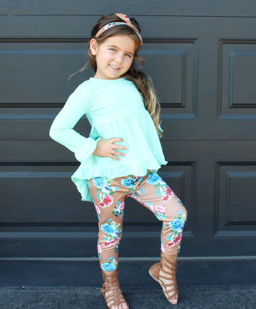 Mint ruffle top that is high in the front and longer in the back comes with brown floral pants and a matching headband
