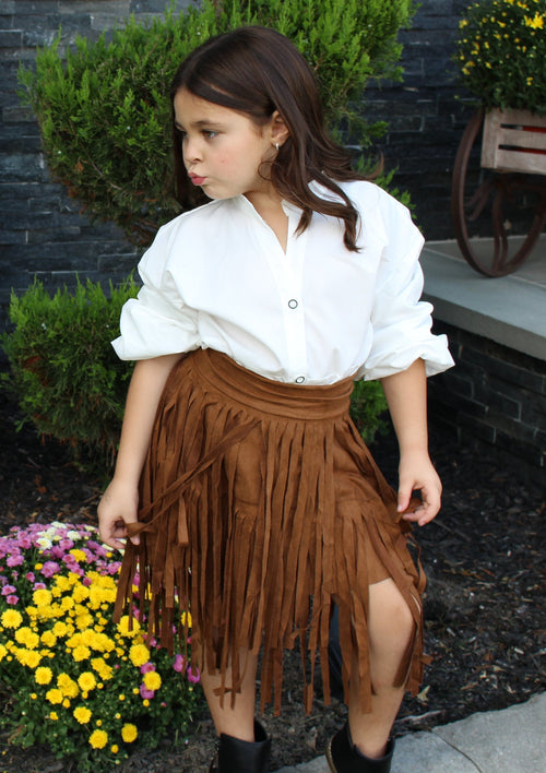 This toddler girl brown skirt is layered with suede fringe. The waist is elastic.