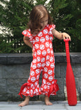 Red bell bottom romper with baseball pattern. Red ribbon is tied into a bow located at the ankle.