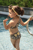This Leopard Bikini 3 piece set comes with the leopard bottom, one side (halter) top and matching gold headband.