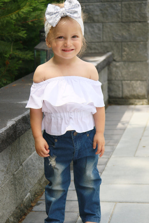 This set is for the cool summer babe who likes to dress the part. This fashionable little girl's outfit comes with the Off The Shoulder Top and Ripped Jeans.