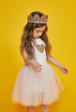 Oh la la fancy! How darling is our Petite Hailey Feather Tutu Dress! This gorgeous dress has gems sitting on top of a feather lining and puffs out at the bottom with tulle. Your sweet baby girl will be the belle of the ball in this gorgeous dress. Add our Adele Feather Cape to complete the look!