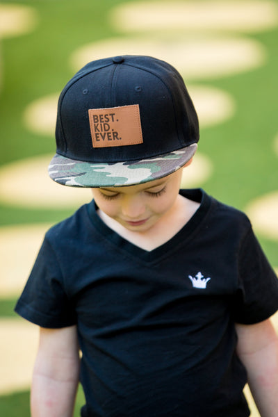 All of our Littlest Prince hats are super trendy and have an excellent fit (says all of our dad models). This trendy snap-back hat is available in different colors and styles and offers excellent shade for your little man. Each hat has a leather patch on the front with an adorable saying. Make sure to add a matching hat for dad!