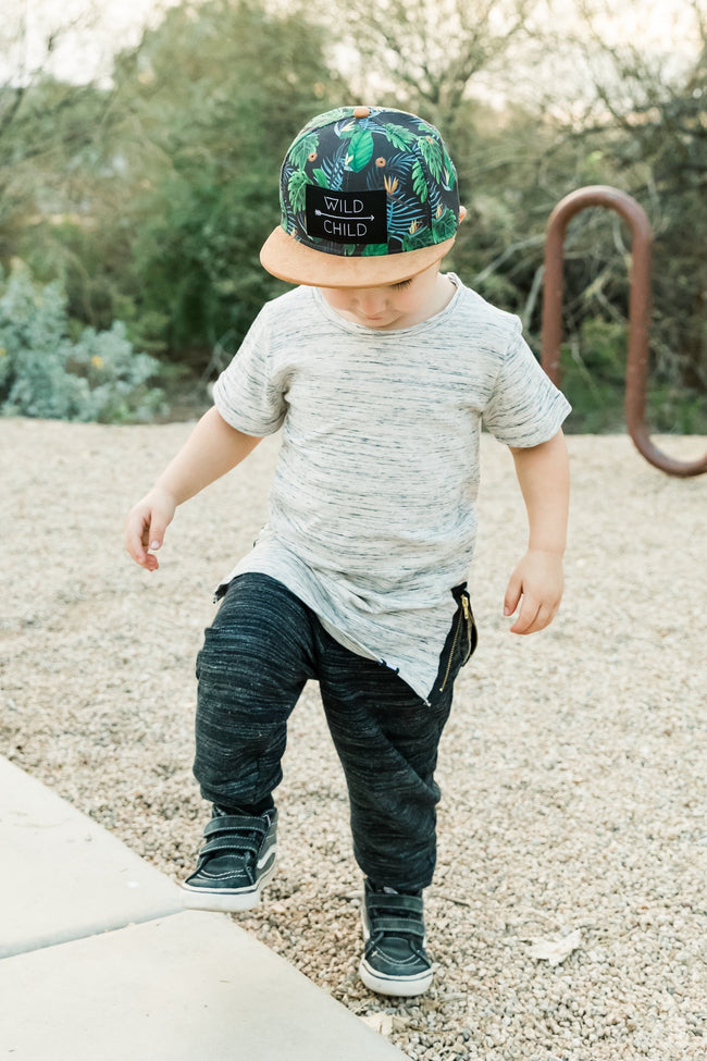 All of our Littlest Prince hats are super trendy and are an excellent fit. This trendy snap-back hat offers excellent shade for your little man. This hat is for the stylish little gents who like to add a little something extra to their outfits! This wild child hat fits toddlers and tweens!