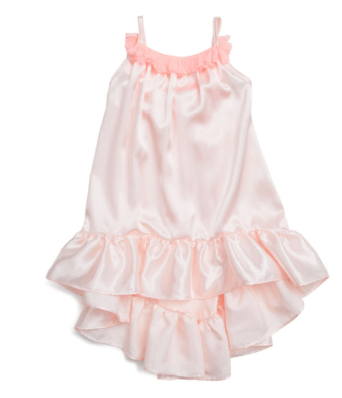 This gorgeous silk dress is just what the beautiful summer weather calls for. This slinky silk bodied dress comes higher in the front and longer in the back turning a fun dress into a fancy party outfit. The front and back are lined with hot pink tassels. Your mini diva will love to give this dress a twirl.