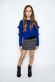 This beautiful Mia NY cobalt blue sweater is sure to make any outfit stand out. With the studded ruffle sleeves and comfy silhouette, it would be paired amazingly with pleather leggings or one of our cute mini skirts. This top can be worn by our toddler diva's all the way up to our tween girls! The Sizes are more fitted so sizing up is recommended if applicable.    Mix and match with our Stud Fringe Skirt and Studded Skater Skirt!