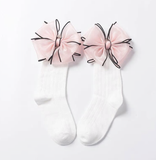 We love big bows and WE CANNOT LIE! Check out our new BIG bow plush socks. They come in two different colors black and pink. Depending on age, they can be worn as anklets or knee highs.  Fit for sizes 2yr-6yrs (can get away with a little smaller and a little bigger)