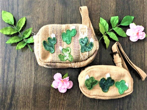 Travel to the beach in style the summer with our new Pricky Bum Bag. Each bag is hand made and has unique detailing including the sparkly sequin cactus patches. The fanny pack style makes it easy with a hands free approach. Perfect for mommy's on the go!  Pairs perfect with our San Pedro jumpsuit and kimono