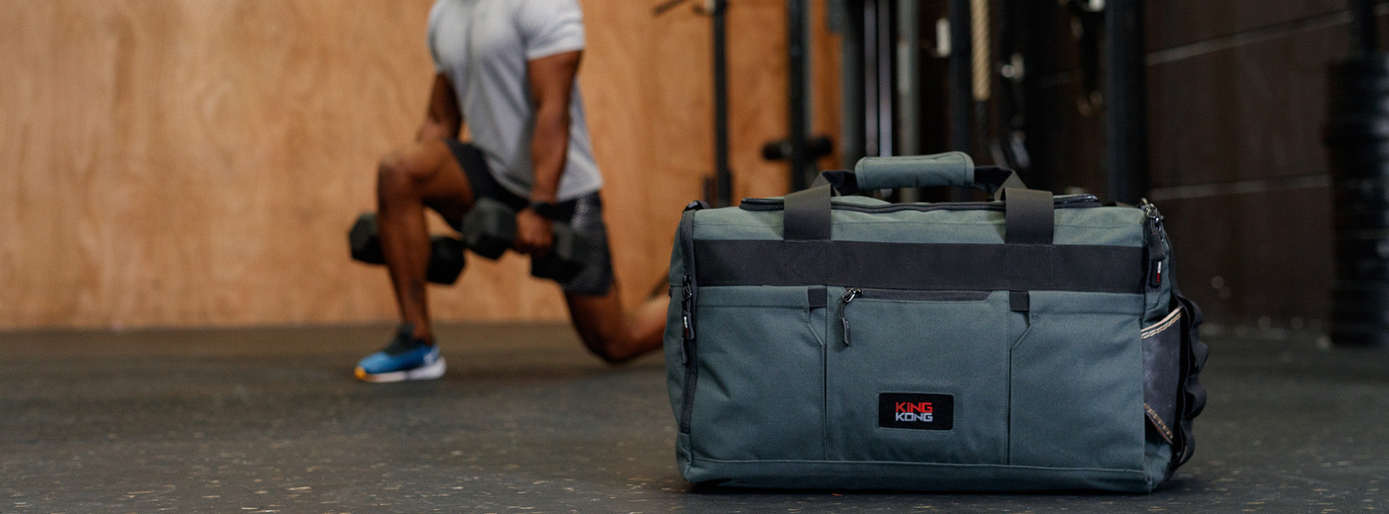 Gym duffel with weightlifting belt attachment