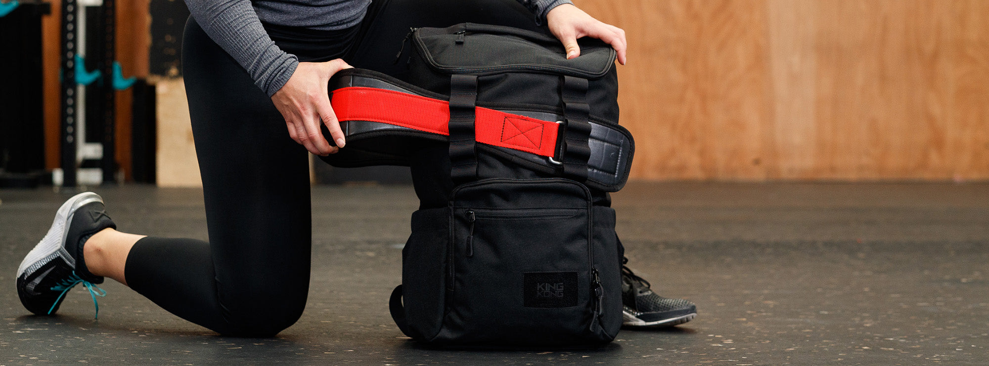 Gym backpack with weightlifting belt attachment