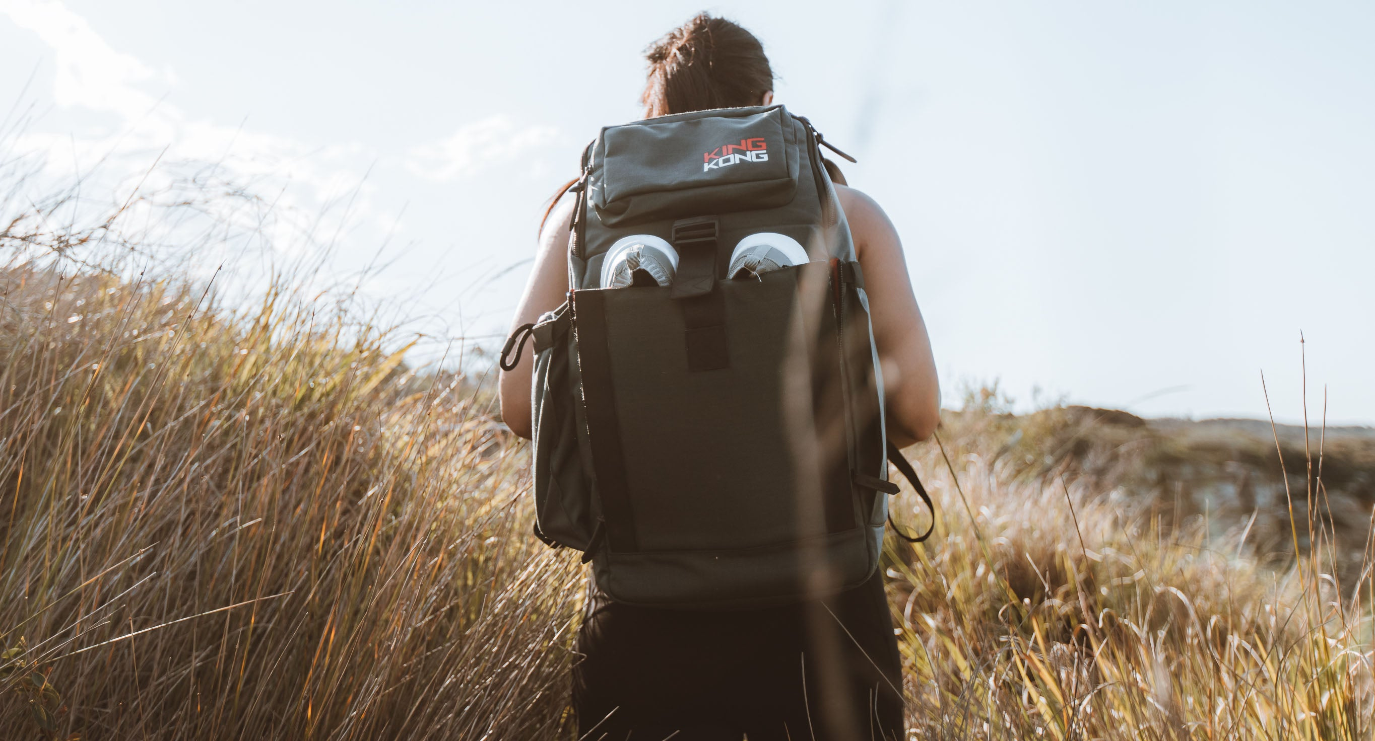Backpack with shoe compartment worn on hike