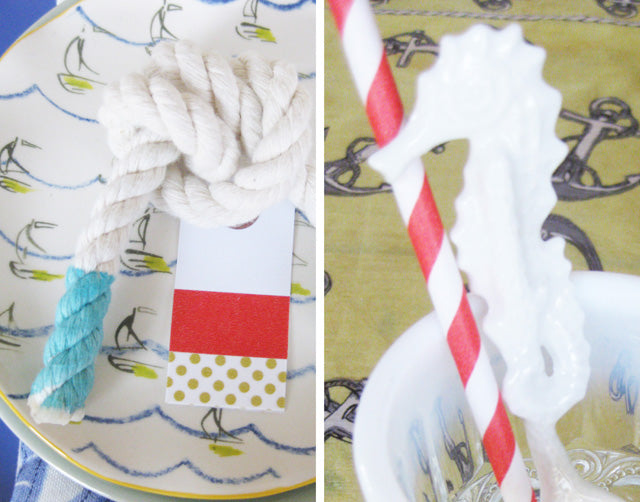 cheery yellow silk anchor scarf as a table runner, dishes in blues and whites, dip-dyed tip of nautical rope stripey straw and a seahorse spoon