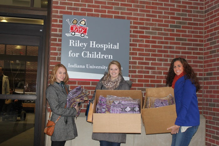 donating boxes of scarves to the Riley Hospital for Children