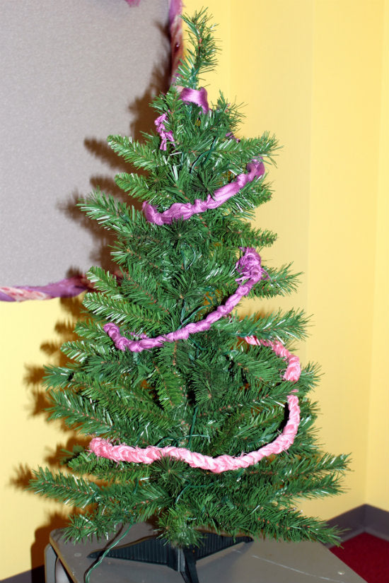 humble tree wrapped in scarf garland