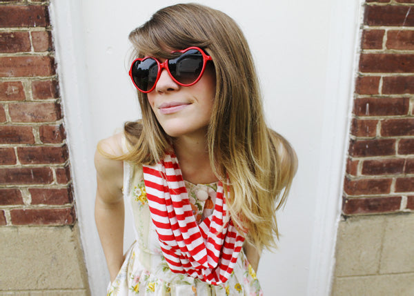 red and white striped scarf on a woman wearing heart frame sunglasses