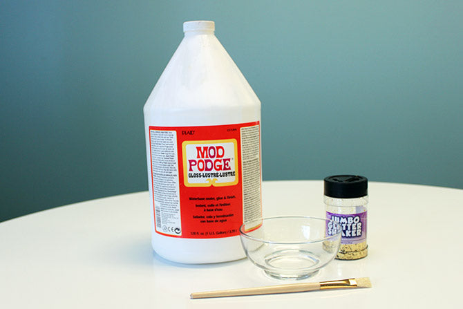 supplies needed to make the DIY gold glitter sparkling vase