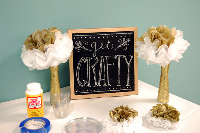 DIY gold glitter sparkling vases on display