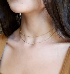 model wearing satellite chain necklace