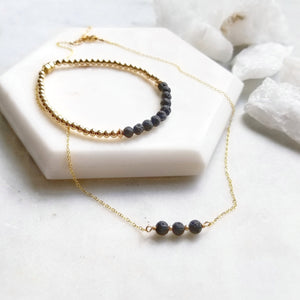 Gold lava stone aromatherapy necklace and bracelet