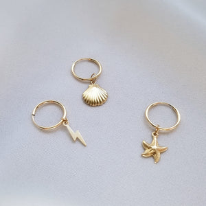 tiny gold filled hoop earrings with shell, starfish and lightning bolt charms