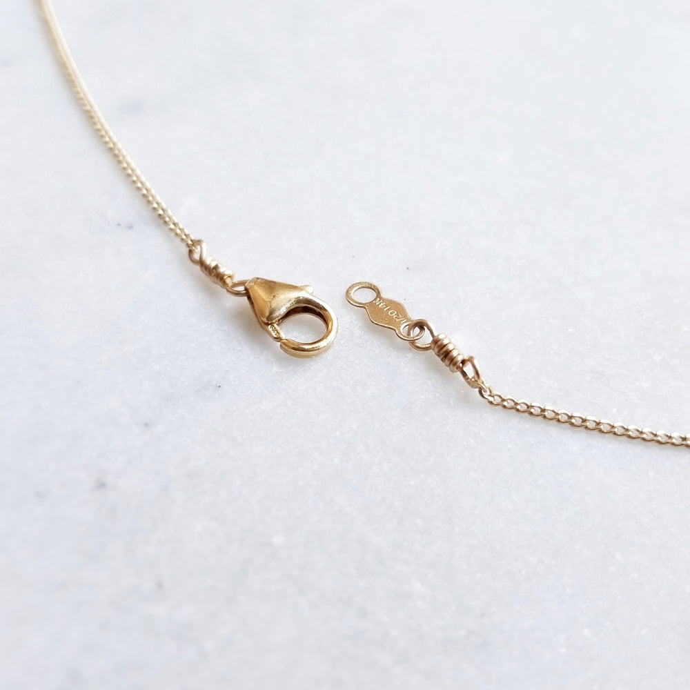 Gold necklace clasp and tag
