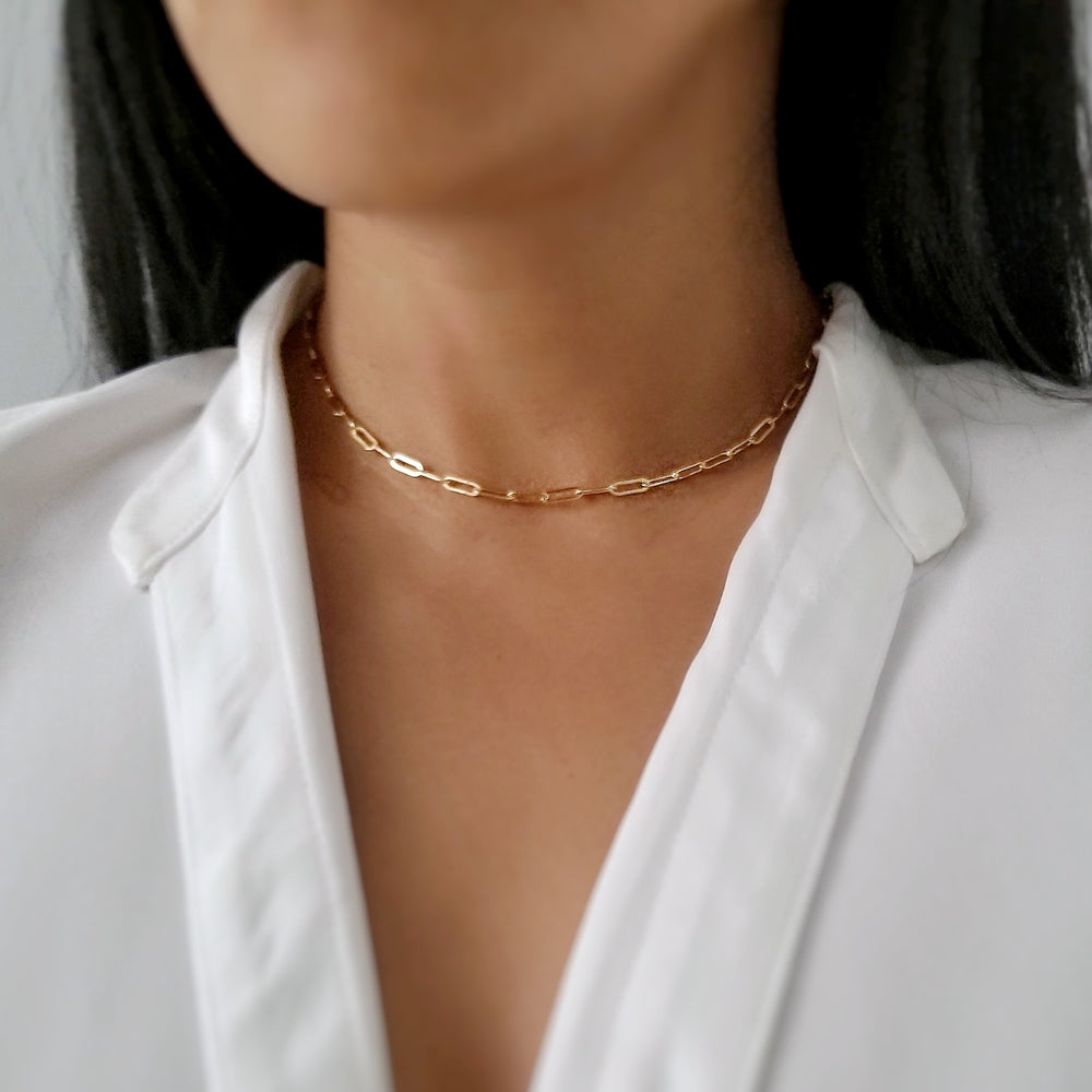 model wearing gold linked necklace