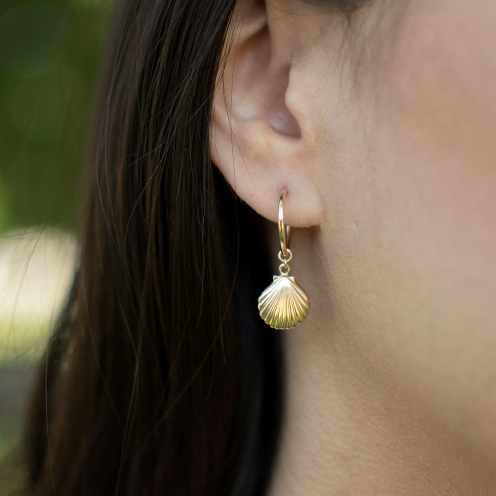 tiny gold filled hoop earrings with gold shell charm