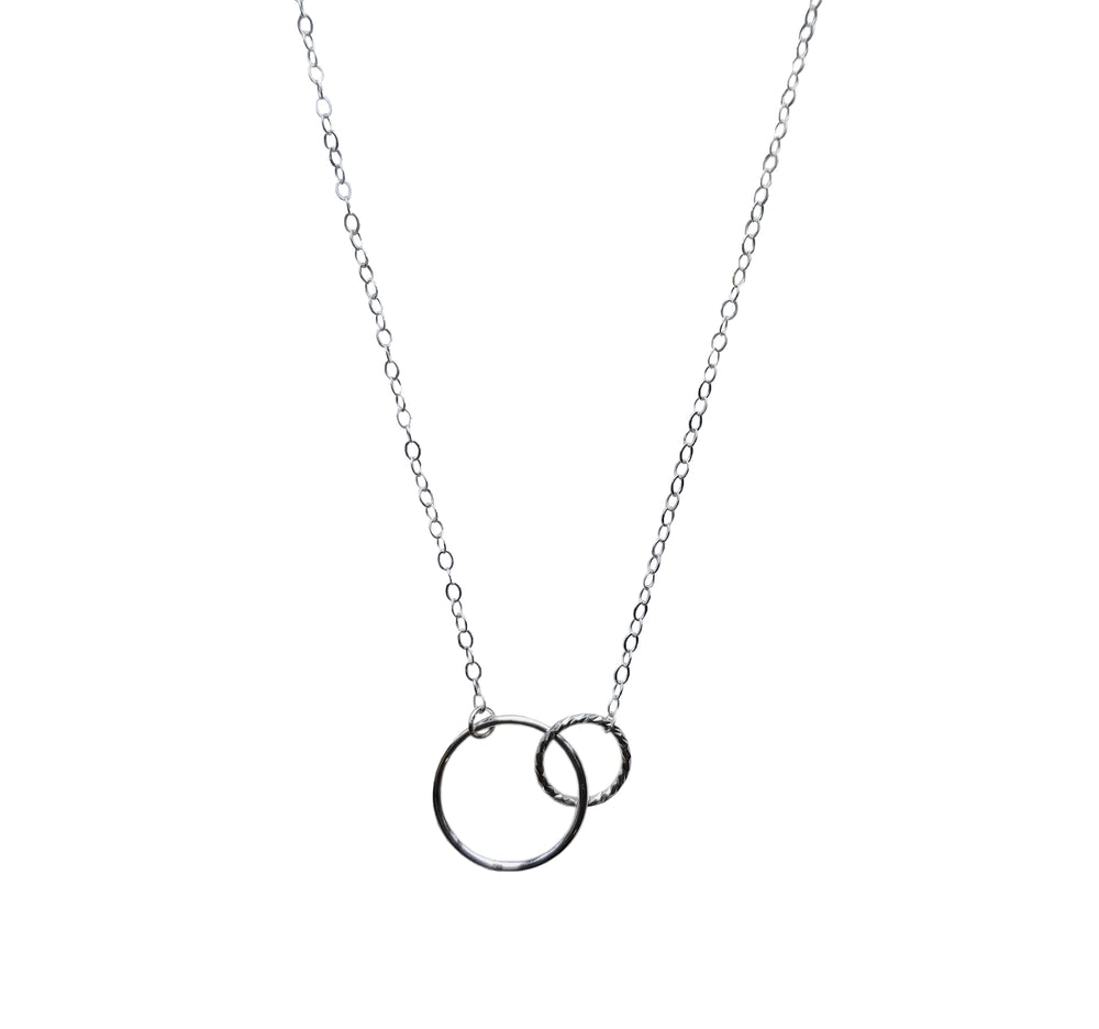 customer wearing gold circle pendant  friendship necklace