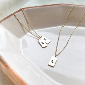 Stamped initial gold tag necklace