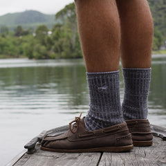 Standing on lake jetty in Pretty Fly merino socks