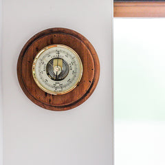 Weather barometer in lake house