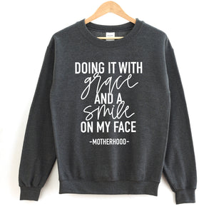 Doing it with Grace and a Smile on my Face - Adult Unisex Charcoal Pullover - West+Mak