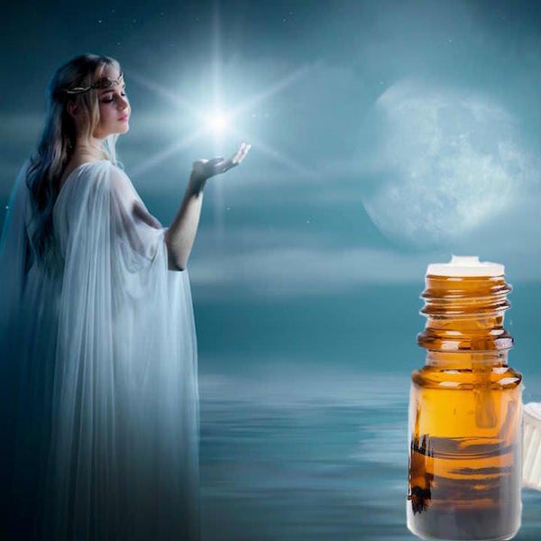 Beautiful goddess with long blond hair and flowing robes holding a star in her hand.  She is in the clouds with a light full moon, a bottle of essential oil in the corner.