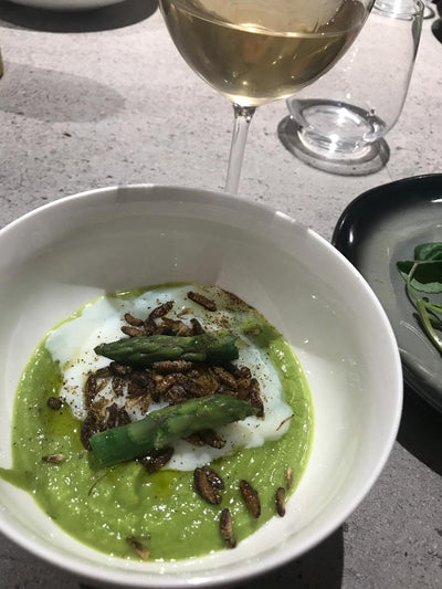 Asparagus cream with soft egg and sautéed crickets