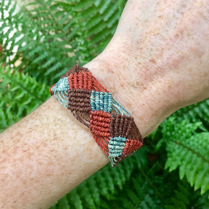 Red, blue and brown string bracelet