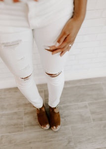 Distressed White Skinny Jeans (size 3 & 11)