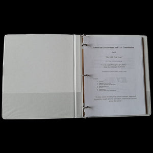 3-ring binder open to cover page.