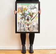 Person holding framed Theater District artwork puzzle.