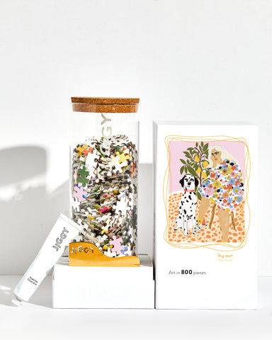 Dog Mom artwork puzzle box with reusable glass jar, tube of puzzle glue and straight-edge tool to spread the glue.