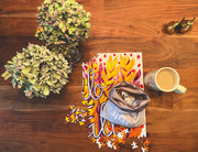 Hello Fall art puzzle by Mel Reese on wood foor with coffee and plants.
