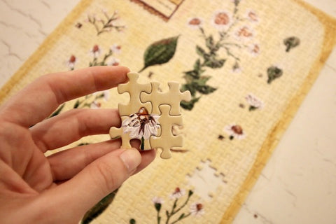 Close up of person holding Floral Lifestyle art puzzle pieces by Taylor Victoria.